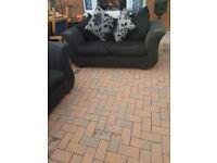 2 beautiful black and grey sofas