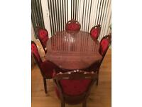 A beautiful solid wood dining table and 8 chairs