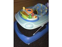 Boys blue baby walker, has different heights.