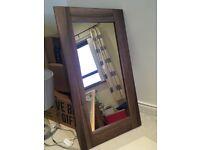 Dark wood wall mirror
