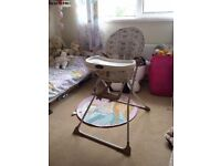 Fold down wipe clean highchair