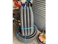 Perforated 2 inch / 60mm drainage pipes , 25m long , 2 available