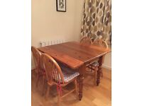 Solid Wood Dining Table and 4 Chairs (table has fold down sides)