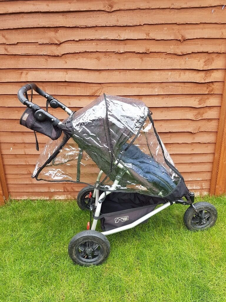 Mountain Buggy Swift with foot muff, rain cover, and car seat adaptor