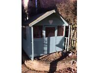 Wooden Wendy house with toy kitchen