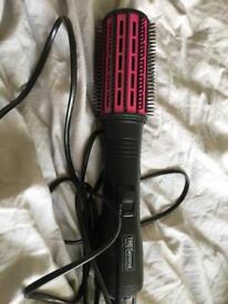 Heated brush