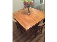 Extendable Solid Oak Dining Table seating between 4-8