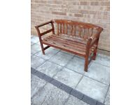 Wooden garden seat , with terracotta upholstered cushion
