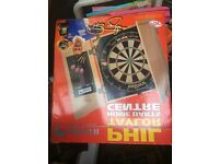Phil Taylor dart board set. Never been used still boxed