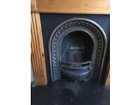 Cast iron fire insert and wooden surround