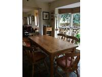 Solid wood dining table and 6 chairs very good quality