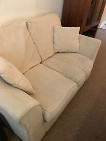 Two Seater Sofa In Beige.