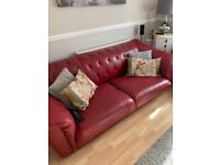 Three and two seater red leather sofas