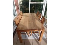 Solid oak dining table and six chairs