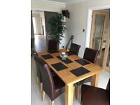 Sold oak table & 6 leather chairs