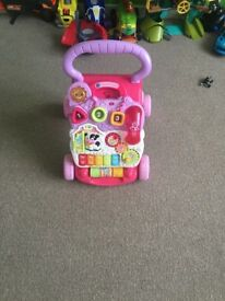 Pink baby walker and toy