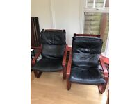 Pair of black leather and walnut wood arm chairs, £10 for both, collection only