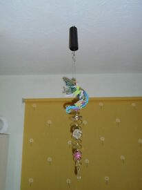 Battery operated rotating hanging pendant
