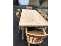 Solid large pine table and six chairs