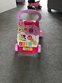 Pink baby walker in excellent condition