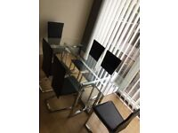 Chrome and glass table, 6 chrome and faux leather chairs