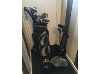 Golf clubs with stand and golf balls