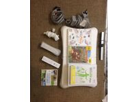 NINTENDO WII CONSOLE WITH GAMES AND WII FIT PLUS AND BOARD