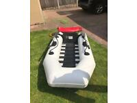 Rib boat dinghy tender (folds away into a bag for storage) with engine outboard 4hp Mercury