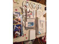 Nintendo Wii bundle including MarioKart wheels, nunchucks, remotes and 9 games