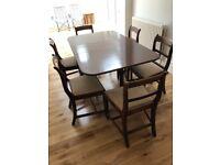 Mahogany dark wood dining table and six chairs
