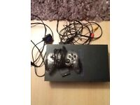 PS2 bundle including Singstar game and microphones and buzz controllers