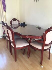 Wooden dining table with glasstop and 4 chairs