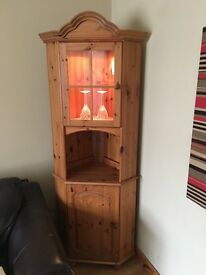 Pine corner unit with under led lighting. Cupboard space below for excellent storage