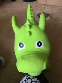 Inflatable hop on dinasour