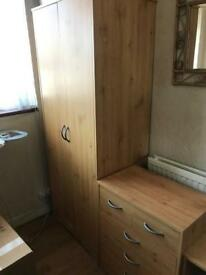 Wooden wardrobe, chest of drawers and side table