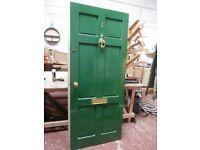 Green on white external timber door