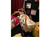 Baby Moses basket and stand, duck themed