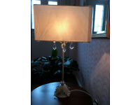 Very delicate looking metal floral table lamp with shade.