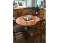 Sakol dining table and four chairs