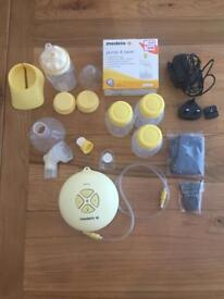 ** SOLD**Medela Swing Electric Breast Pump (plus spare bottles and storage bags)
