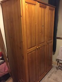 Double wooden wardrobe with shelves
