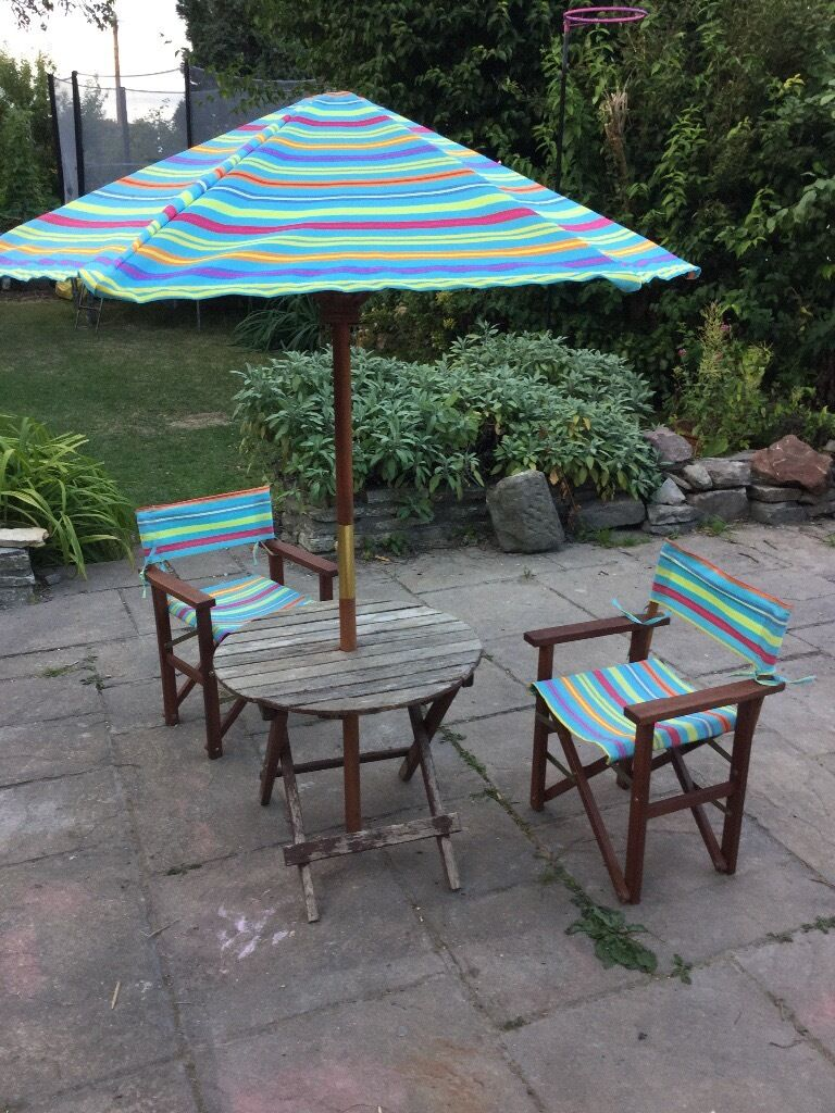 Childrens table plus 2 chairs and umbrella £15