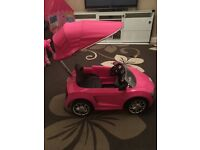 Pink Audi trike with sunroof