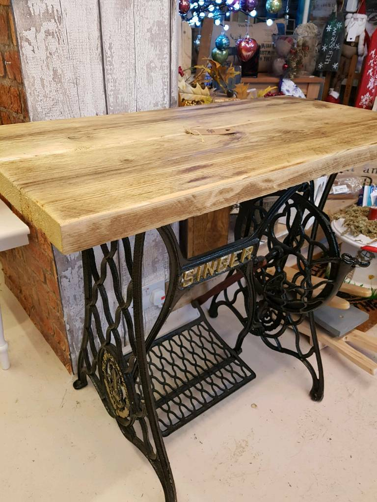 Sewing machine tred with scaffolding top
