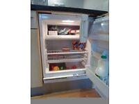 integrated under worktop fridge with integral freezer compartment