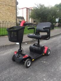 PRIDE GOGO ELITE TRAVELLER LX WITH SUSPENSION IN SEAT POST CAR BOOT MOBILITY SCOOTER