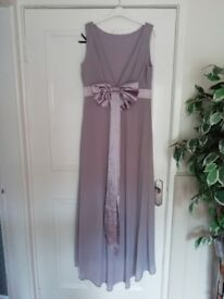 4 bridesmaid dresses.never been worn .smokey grey in colour