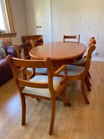 Solid yew wood dining table with 6 chairs. Reasonable condition. Collection only.