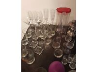 Set of glasses and alcohol accessories of different manufacturers