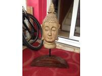 Buddha head with solid carved wood bottom